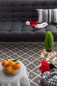 picture of futon  - Cozy interior with Christmas decorations and little green tree - JPG