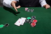 Poker Player Throwing Down A Pair Of Aces