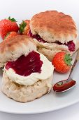 picture of devonshire  - Traditional Afternoon Tea of Devonshire scones topped with clotted cream and strawberry jam often served with coffee or tea