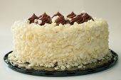 pic of red velvet cake  - Red velvet cake with vanilla frosting and chocolate on top - JPG