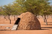 image of nomads  - Closeup of entrance of traditional hut of himba people in Namibia - JPG