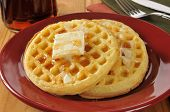 stock photo of buttermilk  - Hot buttered waffles with maple syrup on a rustic wooden table - JPG