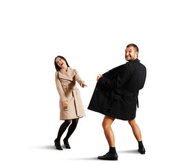 pic of exhibitionist  - laughing woman pointing at man in open coat - JPG
