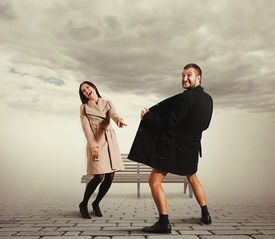 picture of exhibitionist  - laughing woman pointing at exhibitionist in the coat - JPG