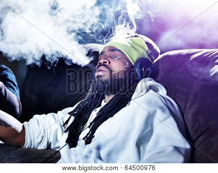 exhaling a big puff of marijuana smoke