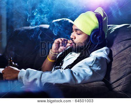 smoking marijuana and drinking beer amid clouds of smoke