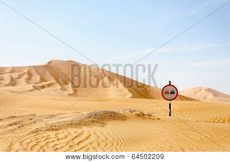 Road Sign Among Sand Dunes In Desert (oman)