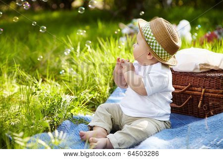 Little Boy In The Garden. Picnic.