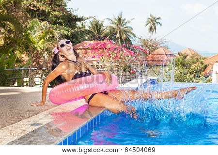 Woman In White Sunglasses With Red Inner Tube