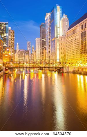 City of Chicago downtown and River with bridges at dusk.