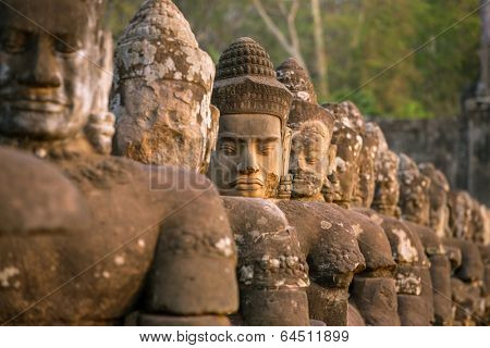 Stone carved statues of Devas on the bridge to Angkor Thom in Angkor complex, Siem Reap, Cambodia