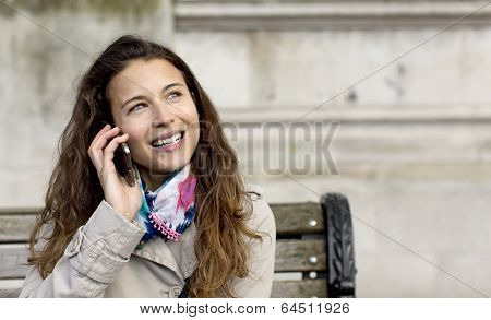 Attractive young woman talking on her phone