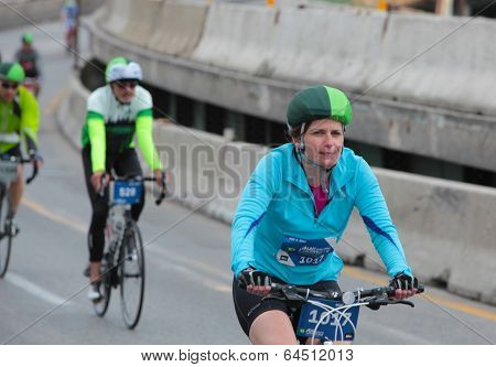 Female rider in TB color helmet cover