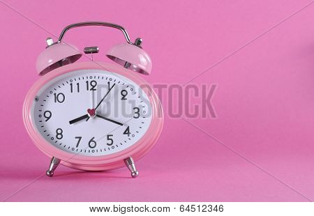 Pretty Pink Vintage Retro Style Alarm Clock With Copy Space On Pink Background For Daylight Saving,
