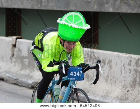 Rider with lime cover on helmet