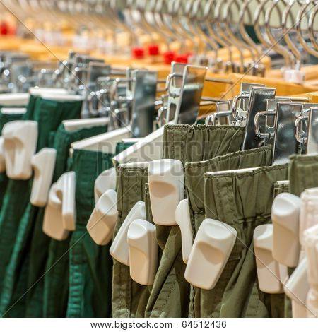 Clothes in the store with EAS anti-theft tags