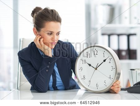 Thoughtful Business Woman Looking On Clock