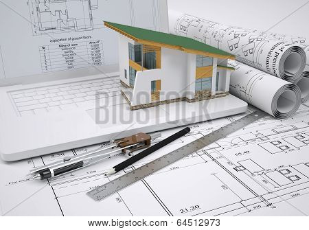Scrolls architectural drawings and small house