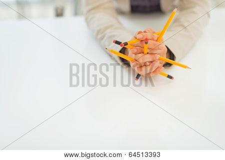 Closeup On Business Woman Holding Pencils