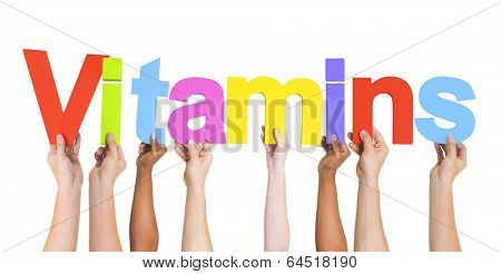 Diverse Hands Holding The Word Vitamins