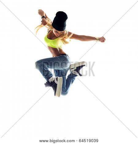 young beautiful dancer posing on studio background