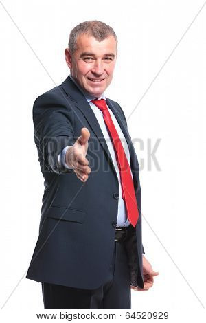 mid aged business man offering you his handshake with a smile on his face. isolated on a white background