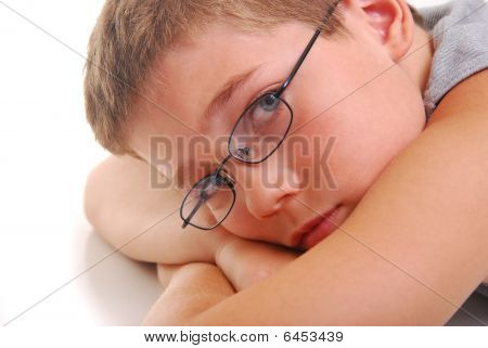 Boy Resting On Arms
