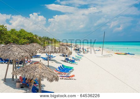 VARADERO,CUBA - APRIL 28,2014 : Tourists relaxing on a beautiful sunny day at the beach