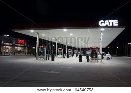 JACKSONVILLE, FL - MAY 5, 2014: A Gate Petroleum gas station at night in Jacksonville. Gate Petroleum is headquartered in Jacksonville and has over 225 gas stations with over 2,200 employees.