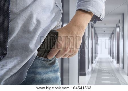 Man holding gun against an corridor background