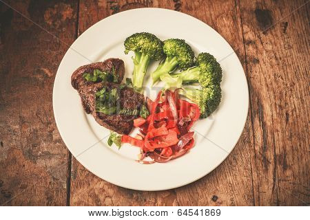 Meat And Vegetables On Plate