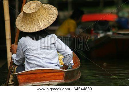 Local people in Thailand living and trading on the river - Damnoen Saduak floating market near Bangkok