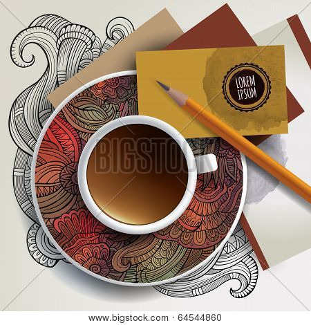 Cup of coffee, business cards and ornaments