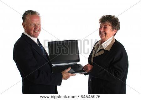 Senior businesman fed up wtih younger assistant teaching him how to use the computer