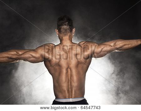 Back of strong muscular with hand extended