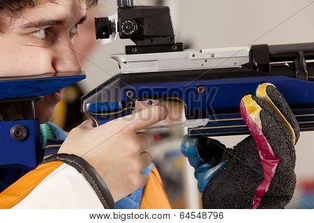 Man training sport shooting with air rifle gun