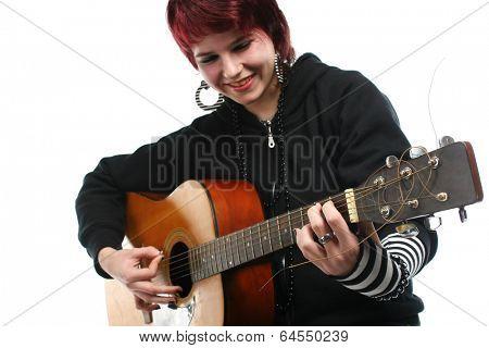 Teenage girl learning to play guitar