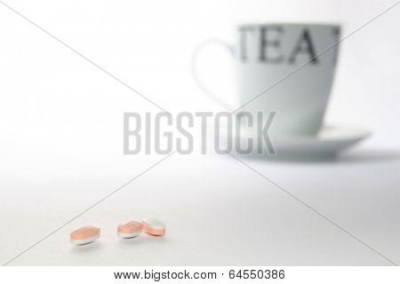 Tea cup and pills