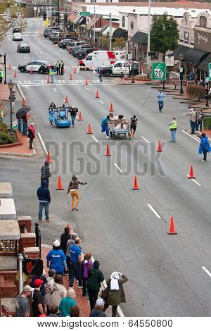 Two Teams Race Beds On City Street In Fundraiser Event