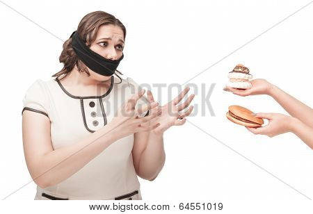 Plus Size Woman Gagged Stretching Hands To Junk Food