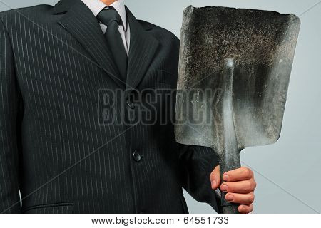 Businessman With Shovel