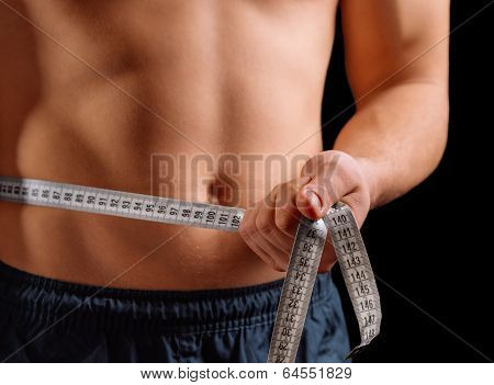 Man Is Measuring Waist With Centimeter Tape