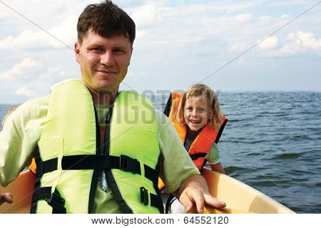 Little Girl And Her Father On A Kayak At Summer