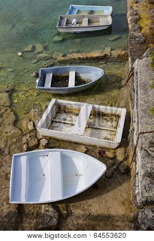 Rowboats tied up at a Bermuda low tide.