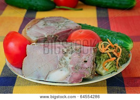 Smoked Pork And Vegetables On A White Plate