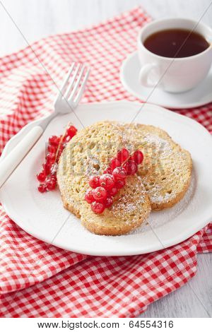 french toast with redcurrant and powder sugar for breakfast