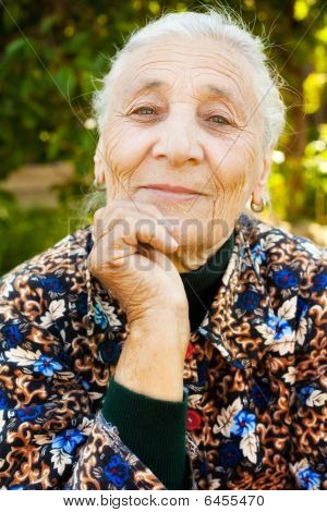 Outdoor Portrait Of One Elegant Senior Woman