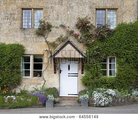 Cotswold Cottage Facade with Flower Border