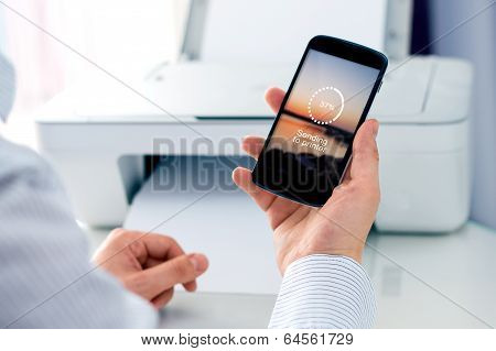 Man sending a photo to printer.