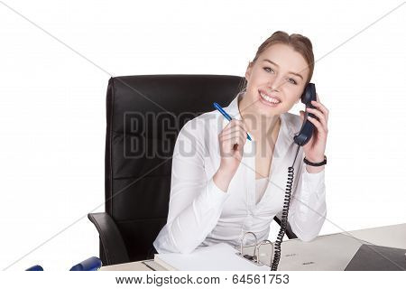 Young Woman Phones At The Desk